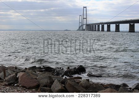 Danish Great Belt Bridge. Photo Of The Bridge And Sea. Bridge Construction.