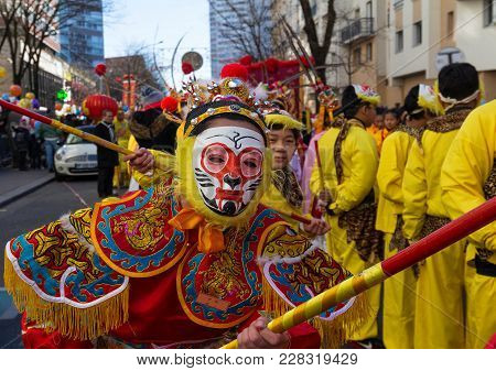 Paris, France - February 25, 2018: Chinese Boy With Traditional Opera Costume In The Parade. The Mai