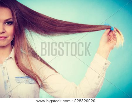 Healthy Look Concept. Girl Combing Brushing Her Hair By Using Plastic Comb. Young Woman Taking Care