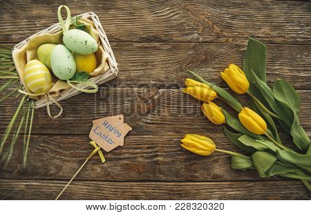 Top View Of Bouquet Of Flowers, Colored Eggs In The Box And Holiday Felicitation
