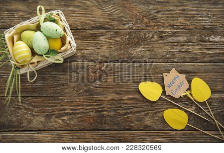 Top View Of Paper Tulips And Basket With Eggs On The Timbered Board