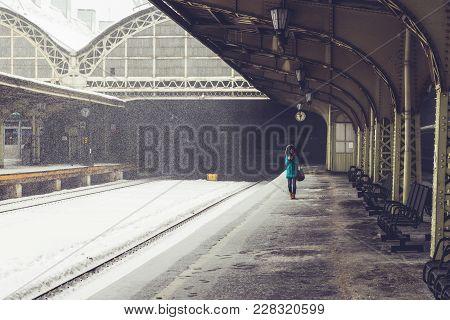 Woman Traveler On Railway Station