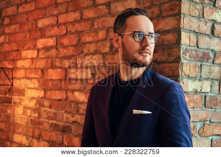 Portrait Of A Stylish Man In A Room With Loft Interior.