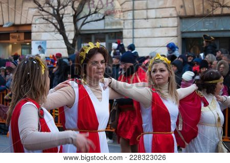 Putignano, Italy. February 11, 2018: The Annual Traditional Costumed Carnival. A Group Of  Women In