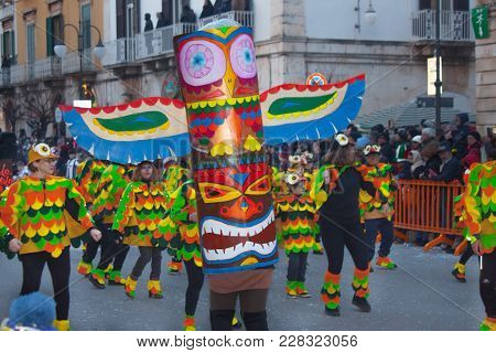 Putignano, Italy. February 11, 2018: The Annual Traditional Costumed Carnival. Dancing Group Of Peop