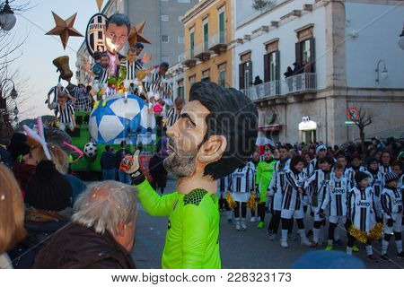 Putignano, Italy. February 11, 2018: The Annual Traditional Costumed Carnival. Man In The Costume Of