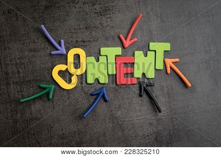 Colorful Arrows Pointing To The Word Content At The Center On Black Cement Wall, Content Is King In