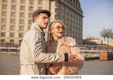 Just Look At This. Stylish Modern Elegant Girl Is Standing On Square With Her Man As They Having Dat