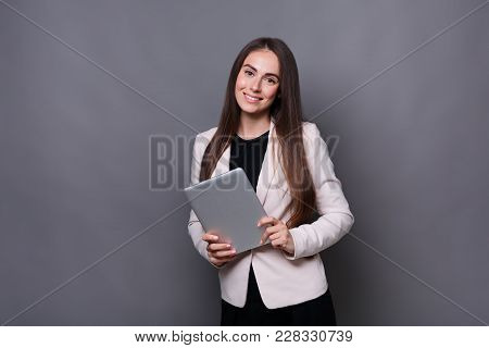 Smart Solutions. Attractive Young Business Woman In Smart Casual Wear Holding Digital Tablet And Smi