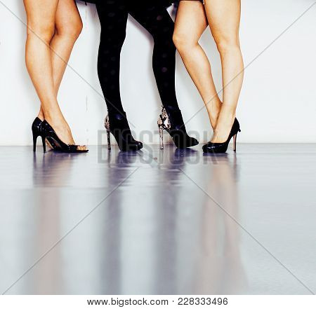 Diverse Type Pair Of Woman Legs In Hight Heels Black Shoes Isolated On White Background And Floor, D