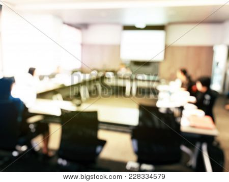 Blurred Image  Of Employees Young Colleagues And Business Team Sitting At The Meeting Room Or Semina
