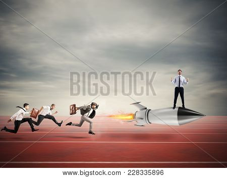 Winner Businessman Over A Fast Rocket Against Competitor. Concept Of Business Competition