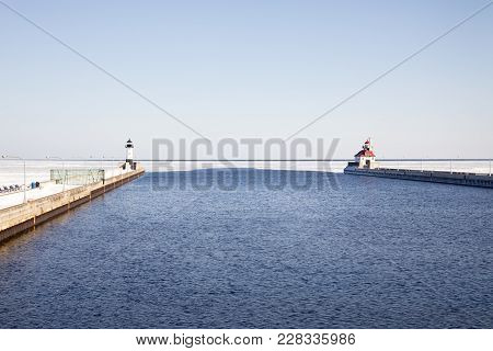 Open Shipping Channel With Lighthouses On Frozen Lake Superior, Duluth, Minnesota