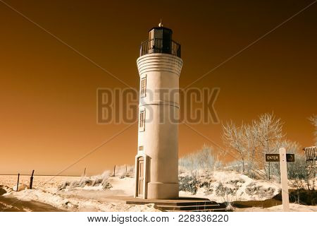 Manning Memorial Lighthouse On Sandy Lake Michigan Beach  In Infrared In Winter