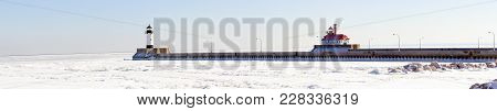 Lighthouses On Frozen Lake Superior Waterfront, Duluth, Minnesota In Winter