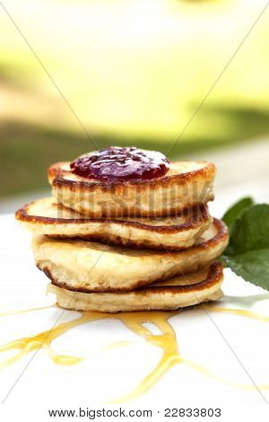 Small Pancakes Covered With Jam