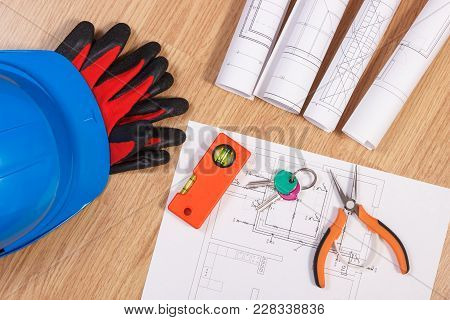 Home Keys With Blueprints Or Electrical Construction Drawings, Protective Helmet With Gloves And Wor