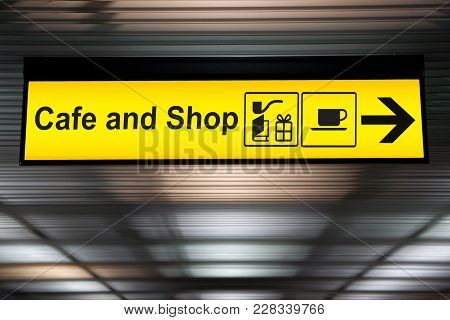 Sign Cafe And Shop With Arrow For Direction For Passenger To Buy Food , Drink And Shopping. Yellow C