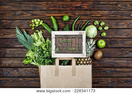 Full Paper Bag With Green Vegetables And Green Fruits. Vegetarian Food. Healthy Food. Supermarket, F