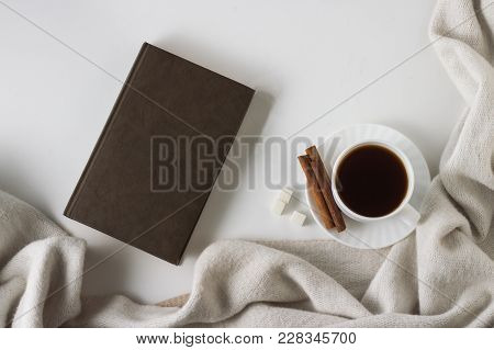 Cup With Coffee, Scarf, Book On The White Background. Flat Lay, Top View