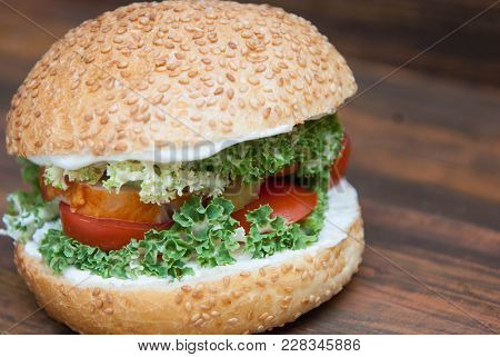 Homemade Hamburger With Fresh Letuce Leaves, Tomatoe Slice, Meat. Homemade Healthy Food Or Fast Food