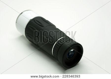 Black Monocular Telescope On Tripod For Bird Watching