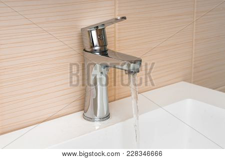Water Running From A Tap - Waste Of Water