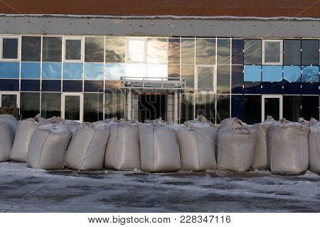 The Rows Of Pallets With Big Bags In Stock, For Further Unloading And Processing