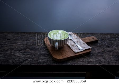 Hot Matcha Green Tea Latte In White Cup On Wood Board Above Wooden Porch With River Behind, Travelin
