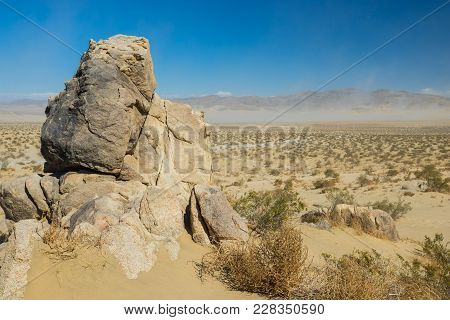 Tall Stone Above Sand Wilderness