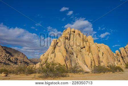 Tall Spine Of Rock In Desert