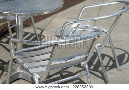 A Sunny Garden Metal Chair And A Table View