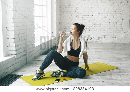 Health, Sports, Fitness, Diet And Weight Loss Concept. Beautiful Young Brunette Female Wiping Sweat