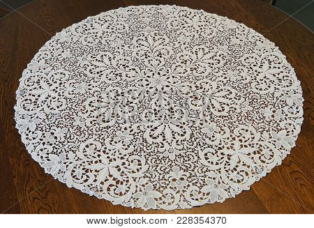 Round Table Cloth On The Wooden Table In The Room