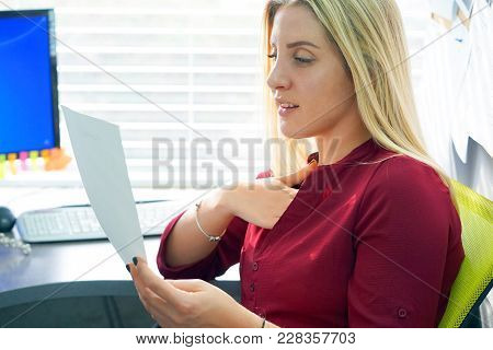 Close-up Of An Office Worker. Woman, Enjoying The Good News In Writing. An Euphoric Girl Is Happy Af