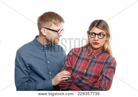 Abusive Young Man With Stubble Trying To Intimidate Blonde Woman In Checkered Shirt, Pulling Her By