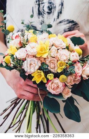 Close-up Of Wonderful Floral Arrangement In Hands Of Professional Florist.