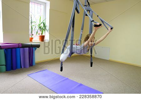 Beautiful Girl Of American Appearance Performs Acrobatic Elements In Air, Child Concentrates And Cal