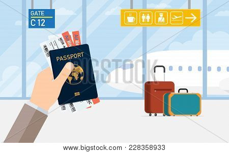 Man Hold Passport And Boarding Pass Waiting Flight Inside Of Airport. Travel, Vacation, Business Tri