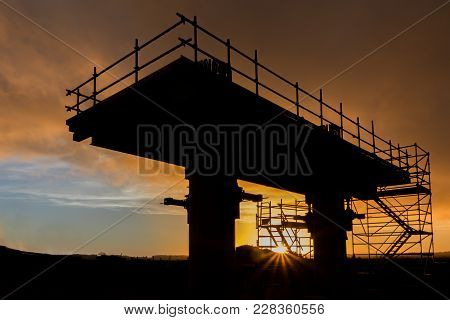 New Bridge Support Under Construction At Sunset.