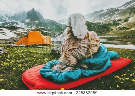 Woman Relaxing In Sleeping Bag On Red Mat Camping Travel Vacations In Mountains Lifestyle Concept Ad
