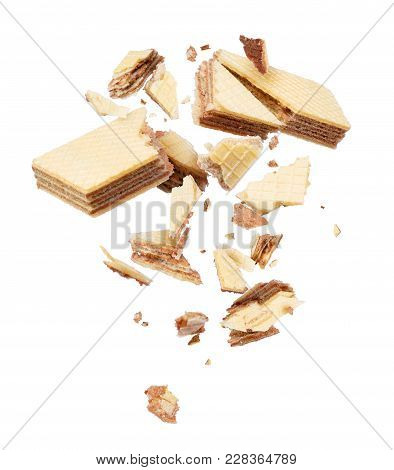 Waffles Broken Into Pieces, Frozen In The Air On A White Background