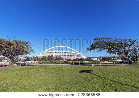 Green Lawn And Trees Against Moses Mabhida Stadium