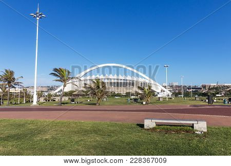 Green Pawn And Paved Walkway Against Moses Mabhida Stadium