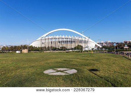 Empty Green Lawn Against Moses Mabhida Stadium