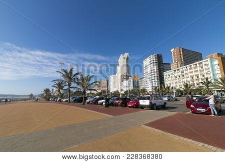 Empty Paved Promenade Against Coastal Beachfront City Skyline