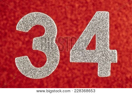 Number Thirty-four Silver Color Over A Red Background. Anniversary. Horizontal