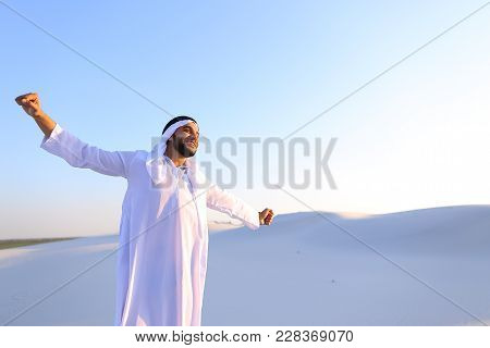 Handsome Young Emirate Strolls And Stretches, Spreads Hands To Sides And Rests From City Bustle, Exa