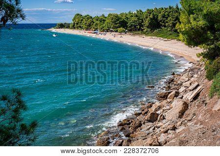 Beautiful Scenery Seascape On Halkidiki Peninsula, Greece. Sandy Beach With Green Pines. Pure Turquo