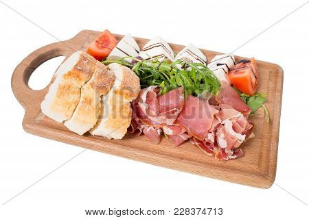 Starter Platter With Prosciutto Crudo And Fresh Vegetables. Isolated On A White Background.
